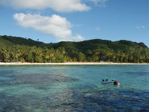 Man in the Water. Man snorkeling in the water, Rarotonga, Cook Islands, South Pacific Royalty Free Stock Photography