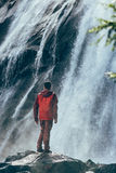 Man beside waterfall Stock Photos