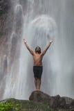 Man at waterfall Royalty Free Stock Images