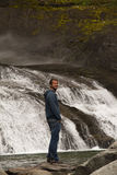 Man at a waterfall Royalty Free Stock Images