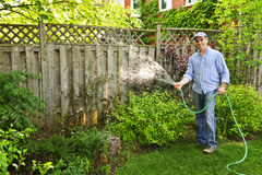 Man watering garden stock photo