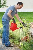 Man watering garden Royalty Free Stock Image