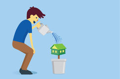 Man watering a houes Royalty Free Stock Photos