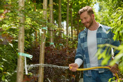 Man watering plants in garden Royalty Free Stock Photography