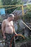 Man watering seedling Stock Images