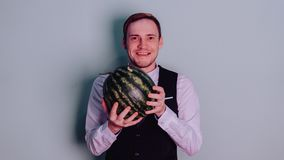 A man and a watermelon / Boy in classic suit with a watermelon. Boy in classic suit with a watermelon / A man and a watermelon n Royalty Free Stock Images
