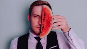 A man and a watermelon / Boy in classic suit with a watermelon. Boy in classic suit with a watermelon / A man and a watermelon n Stock Images