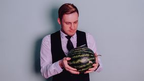 A man and a watermelon / Boy in classic suit with a watermelon. Boy in classic suit with a watermelon / A man and a watermelon n Royalty Free Stock Photo