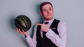 A man and a watermelon / Boy in classic suit with a watermelon. Boy in classic suit with a watermelon / A man and a watermelon n Royalty Free Stock Image