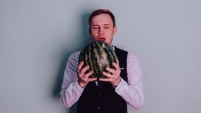 A man and a watermelon / Boy in classic suit with a watermelon. Boy in classic suit with a watermelon / A man and a watermelon n Stock Photos