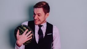 A man and a watermelon / Boy in classic suit with a watermelon. Boy in classic suit with a watermelon / A man and a watermelon n Royalty Free Stock Photography