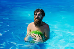 Man with watermelon in swimming pool Royalty Free Stock Photos