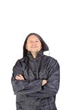 Man in waterproof coat with hood. Royalty Free Stock Photography