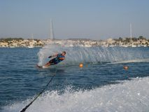 Man waterskiing slalom Stock Images
