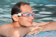 Man in watersport goggles swimming in pool Royalty Free Stock Image