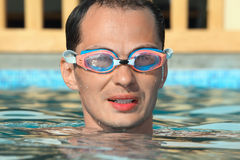 Man in watersport goggles swimming in pool Stock Photos