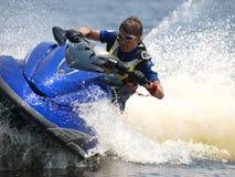 Man on WaveRunner - extreme sport. Man on WaveRunner turns very fast Royalty Free Stock Photo