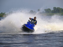 Man on WaveRunner on the water Stock Image