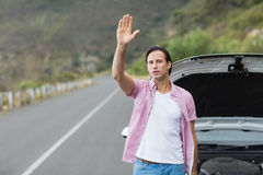 Man waving after a breakdown Stock Image