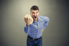 Man waving his big fist and looking Royalty Free Stock Images