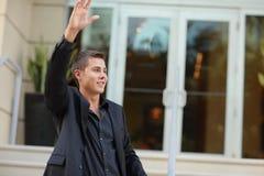Man waving his hand Royalty Free Stock Photography