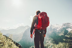 Man wayfarer enjoying mountains Travel Lifestyle. Concept adventure active summer vacations outdoor hiking sport with red backpack Stock Photography