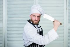 Man wear apron cooking in kitchen. Man use sharp cleaver knife. Types of knives. Sharp knife professional tool. Chef stock photos