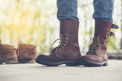 A Man Wear a Brown Boots and Jeans Stock Images