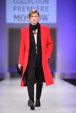 Man wear coat from Slava Zaytzev walk catwalk Royalty Free Stock Image