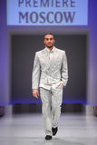 Man wear gray suit from Slava Zaytzev. MOSCOW - FEBRUARY 22: Man wear gray suit from Slava Zaytzev walk the catwalk in the Collection Premiere Moscow, a leading Royalty Free Stock Images