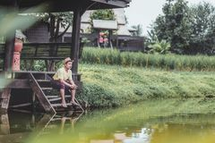 Man wear hat near the river for relax between travel. stock photography