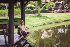 Man wear hat near the river for relax between travel. stock images