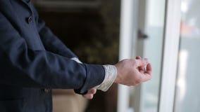 Man wear his jacket near the window stock footage