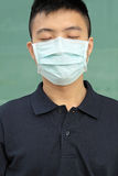 Man wear mask. Outdoor close his eye Stock Image
