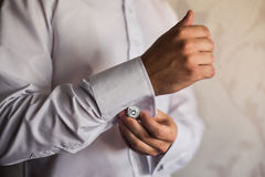 Man wear a shirt and cufflinks, correct clothes, dressing. Man's style, fees groom, wedding preparations, sense of style Stock Photos