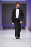 Man wear suit from Slava Zaytzev walk catwalk Stock Photo