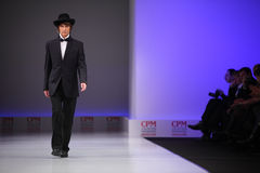 Man wear suit from Slava Zaytzev walk catwalk Royalty Free Stock Image