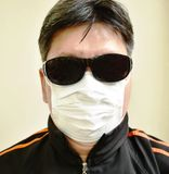 Man wear sun glass and hygienic mask for protected pollution in white background. Asian man wear sun glass and hygienic mask for protected pollution in white royalty free stock photos
