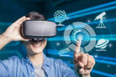 Man wear vr learning astronomy. With the technology background stock photos