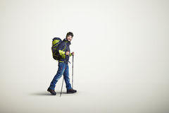 Man wear winter clothes with hiking poles Royalty Free Stock Image