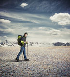 Man wear winter clothes with hiking poles in the mountains Royalty Free Stock Photo