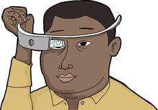 Man With Wearable Technology. Black man fitting wearable technology glass device on head Royalty Free Stock Image