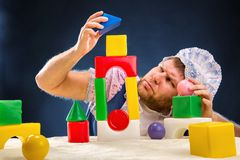 Man weared as baby playing Stock Photography