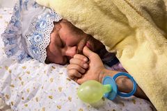 Man weared as baby sleeping Stock Photography