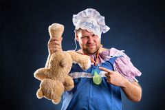 Man weared as baby and toy Royalty Free Stock Photo