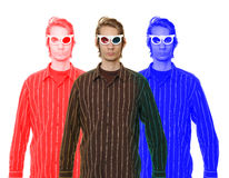 Man Wearing 3D Glasses. A young man wearing retro 3D glasses in a button up shirt isolated on white background royalty free stock photo