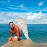 Man Wearing Angel Wings Stock Photo
