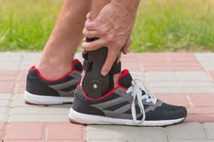 Man wearing ankle brace Royalty Free Stock Images