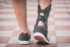 Man wearing ankle brace Royalty Free Stock Photos