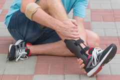 Man wearing ankle brace Stock Photography